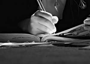 Girl-Writing-in-Book-300x214